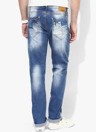 buy spykar blue mid rise narrow fit jeans for men online india