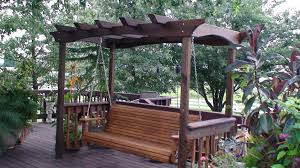 Brown Wooden Porch Swing With Dark Espresso Pergola Stand Plus