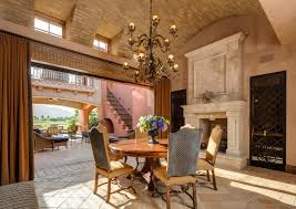 Mediterranean Dining Room With Wrought Iron Chandelier Wooden Table Set Sand Color On Ceiling