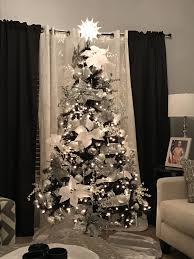 Black Christmas Tree With Silver And White Decorations Decorated By Donna Munoz