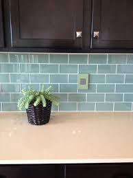 stunning green subway tile backsplash on kitchen with blue glass