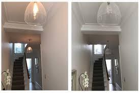 designer lighting glass pendant lights in a hallway
