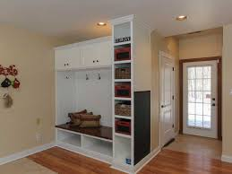 traditional mud room with built in bookshelf high ceiling