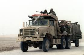 100 5 Ton Dump Truck Members Of Naval Mobile Construction Battalion Travel Along A Main