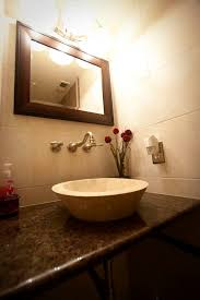 los angeles vessel powder room transitional with wood mirror