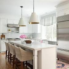 Beige And Pink Accents In White Kitchen