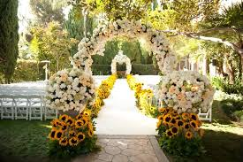 Elegant White Rustic Wedding Arch Flowers Arrangement Matched With Right Guests Chairs And