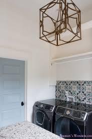 white marble porcelain tile shaw floors gold lantern chandelier