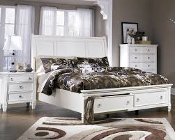 white bed with storage footboard by ashley