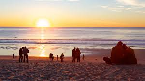 Central California Which Includes A Sunset Beach And Bay Or Harbor