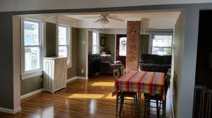 Exposed Chimney Open Floor Plan Farmhouse Living Room
