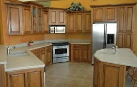 Home Depot Unfinished Kitchen Cabinets by Large Brown Wooden Kitchen Cabinet With Stove Also White Counter