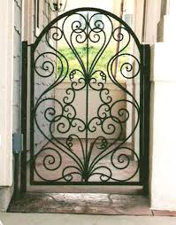 Iron Gates - Here's A Small Iron Gate With A Dec... Front Doors Gorgeous Door Gate Design For Modern Home Plan Of Iron Fence Best Tremendous Rod Gates 12538 Exterior Awesome Entrance And Decoration Using Light Clever Designs Homes Homesfeed Hot Simple In Kerala Addition To Firstrate 1000 Ideas Stesyllabus Concrete Driveway Automatic Openers With