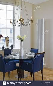 Blue Upholstered Chairs Set Round A Dining Table Near A Window With ... Brynwood White 5 Pc Round Ding Set With Blue Chairs Room Carmilla Damask Chair Espresso Wood Decor Black Contemporary With Wooden Table And Perfect Navy House Seven Design Build Shop Hanover Traditions 5piece In 4 And Farmhouse Fniture Skagen Round Table Oak Gripsholm Chair Entrancing New Roll Squire Parsons Slipcover Rectangle Brown Legs Combined Excerpt Shabby In A Range Of Styles Ireland Dfs Ideas Ikea