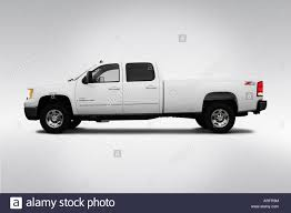 2007 GMC Sierra 2500 SLT In White - Drivers Side Profile Stock Photo ... Gmc Sierra 3500hd Overview Cargurus 2007 1500 Photos Informations Articles Bestcarmagcom 2008 Denali Awd Review Autosavant 2500hd Slt Regency Lifted Gmc Tis 538mb Rough Country Suspension Lift 7in Guys Automotive 2500 Clsc For Sale Classiccarscom Cc10702 Pinterest Denali Sierra Truck Digital Guard Dawg Mayhem Warrior 75in Texas Edition Top Speed