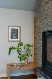 Photos Hgtv Contemporary Corner Display Featuring Rock Fireplace Surround Built In Wood Table And Simple Decor