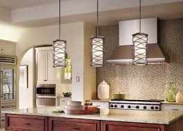 image of hanging lights above kitchen island with picture of