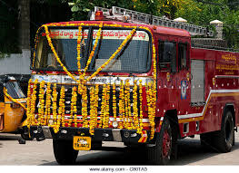 Indian Fire Engine Covered In Flower Garlands During The Hindu Festival Of Dasara Andhra Pradesh