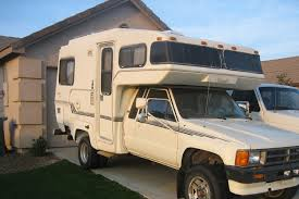 Types Of Toyota Motorhomes | Gone Outdoors | Your Adventure Awaits Jack Photographer Four Wheel Campers Low Profile Light Weight Inside Goose Gears Custom Tacoma Camper Outside Online Leentu Converts Toyota Into A Comfy Place To Camp Dfw Corral Half Shell Casual Turtle Pop Up 2019 20 Top Car Models Feature Earthcruiser Gzl Truck Recoil Offgrid 2014 Tundra Crewmax Trd With Fwc Raven Package Life On The Road In My House Karsten Delap Announces Popup Adventure