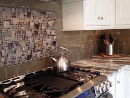 glass tile backsplash with framed mosaic tile insert the