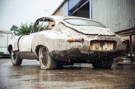 How much do you think this rusting Jaguar E Type is worth