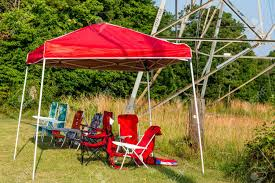Empty Folding Chairs Sitting Along Side A Road Under A Canopy Stock ... Cheap And Reviews Lawn Chairs With Canopy Fokiniwebsite Kelsyus Premium Folding Chair W Red Ebay Portable Double With Removable Umbrella Dual Beach Mac Sports 205419 At Sportsmans Guide Rio Brands Hiboy Alinum Pillow Outdoor In 2019 New 2017 Luxury Zero Gravity Lounge Patio Recling Camping Travel Arm Cup Holder Shop Costway Rocking Rocker Porch Heavy Duty Chaise