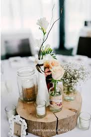 Rustic Country Wedding Centerpiece Decoration With A Wood Slice Vintage Milk Vases And Garden Flowers