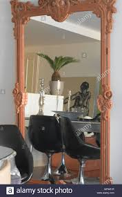 Details Of A Large Framed Mirror Reflecting The View Of A ... Exciting Eclectic Ding Rooms Boho Style That Can Fit In Top 5 Room Rug Ideas For Your Overstockcom Now You Have The Bohemian Of Dreams Get Look Authentic Midcentury Modern Design By Havenly Amazoncom Yazi Red Mediterrean Tie On 20 Awesome And Decor Photo Bungalow Rose Legends Fniture 6pc Rectangular Faux Cement Set In Chestnut