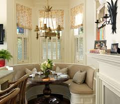Example Of A Classic Dining Room Design In Boston With White Walls