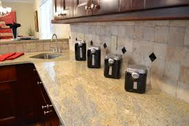new granite countertops and tile backsplash vision pointe homes