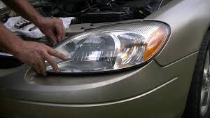 changing a headlight in two minutes ford taurus