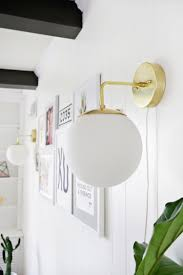 make this beautiful brass globe sconce click through for