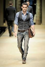 Male Catwalk Model Wearing Pale Blue Chequered Shirt Grey Button Up Vest Distressed