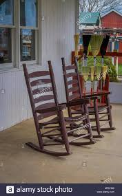 Outdoor View Of Two Wooden Rocking Chairs In A Balcony Of A House In ... Zero Gravity Folding Rocker Porch Rocking Chair Chairs 10 Best 2019 Brackenstyle Premier Grade A Teak Wooden Outdoor Shop Colonial Cherry Finish 28w X 36d 445h Venture Forward With Removable Pad Bluegray Gander How To Draw Plans Diy Free Download Cedar Trellis Minimal Style Convient Cozy Upholstered Beige Mhc Living Best Rocking Chairs The Ipdent Charleston Acacia Ercol Originals Chairmakers Heals