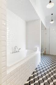 black and white bathroom with arched bathtub alcove transitional