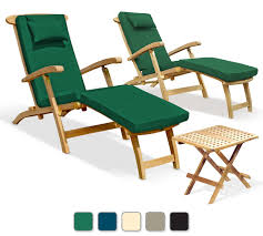 two serenity teak steamer chairs with green cushions and picnic