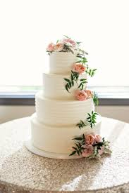 Rustic Buttercream Frosted Wedding Cake Decorated With Organic Pink Flowers And Greenery Created By