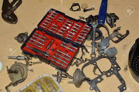 Tools Spread Out On Work Table To Clean And Repair Truck Carburetor ...