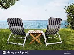 100 Rocking Chair With Books Two Deck Chairs And Books At Lake Stock Photo 26986208 Alamy