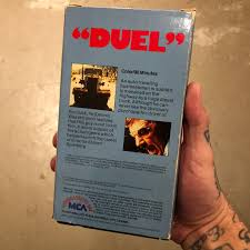 Duel 1971 VHS (USED) – Vinegar Syndrome Preview Road Rage 3 Bloody Disgusting Celebrities Graves Page 11 Pentaxforumscom Truck Stop Wikipedia Needle Nose Peterbilt 351 Axle Semi Pinterest Duel Tv Movie 1971 Imdb Steven Spielbergs The Ransom Note Watch A Semi Truck And School Bus Duel On Texas Inrstate Bridgestone Raises Offer For Pep Boys Trumps Icahn Fortune Car Fast Driving On Route Tf38 In Middle Of Volcanic Lava Business Dog Workshop Cast Crew Guide