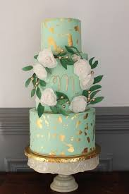 Mint Wedding Cake With Gold Leaf And Flowers