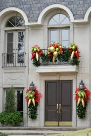 100 Outdoor Christmas Decorations Ideas To Make Use by Outdoor Christmas Porch Decorations Lighted Garland And Red Bows