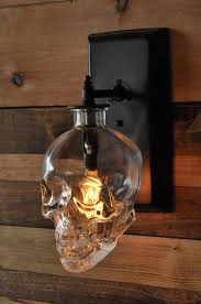 lighting expert creates a spooky skull wall sconce from recycled