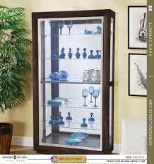 Curved Glass Curio Cabinet by Howard Miller Five Glass Shelves Curio Cabinet With Sliding Door