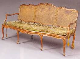 canape louis xv provincial louis xv period walnut and caned canapé mid