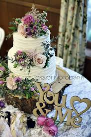 Bohemian Wedding Cake Flowers Pink And Purple Roses Rustic Check Out More At Lisafosterdesign