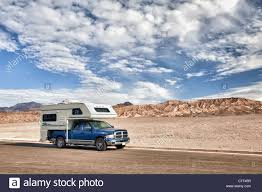 USA, California, Death Valley, Truck Camper On Road Stock Photo ... Alaskan Campers Kodiak Truck Camper Google Search Survival Vechile Pinterest Building A Great Overland Expedition Truck Camper Rig By Nucamp Rv Cirrus Slideouts Are They Really Worth It The Top 7 From The 2016 Expo New 2018 Lance For Sale Boise Id Popup Aframe Camperla Roulotte Portal Cabins 2017 Palomino Bpack Ss1200 Pop Up Campout In Rvs Rvtradercom Northern Lite Sales Manufacturing Canada And Usa Travel Rayzr Halfton Caboverless