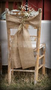 Burlap Sash With A Little Bunch Of Babys Breath Flower For The Chair Decoration In Rustic Wedding Whitewashed Wood Makes It Even More