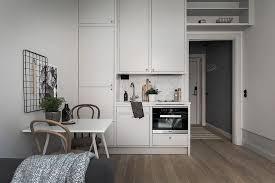 Tiny Kitchen In A Scandinavian Studio Apartment Loft ApartmentsTiny ApartmentsStudio SpacesTiny SpacesNordic Interior DesignTiny