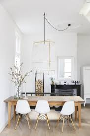 bright dining room with wooden table and white chairs